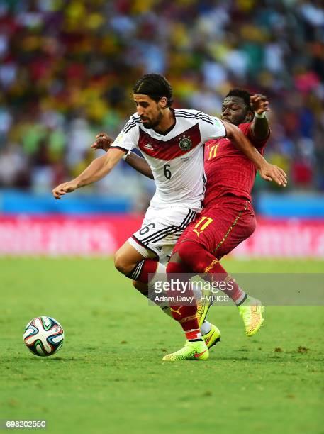 Germany's Sami Khedira shields the ball from Ghana's Sulley Muntari