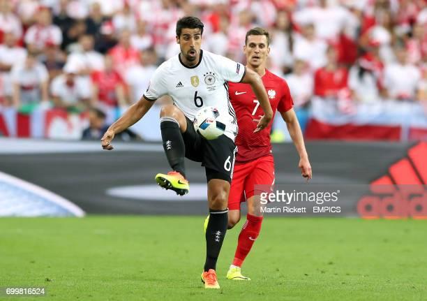 Germany's Sami Khedira shields the ball from Poland's Arkadiusz Milik