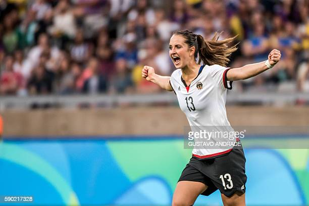 Germany's Sara Daebritz celebrates after scoring against Canada during their Rio 2016 Olympic Games women's semifinal match at the Mineirao stadium...