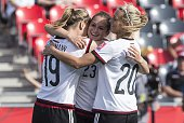 Germany's Sara Daebritz celebrates with Lena Petermann and Lena Goessling after scoring against Ivory Coast during a Group B match at the 2015 FIFA...