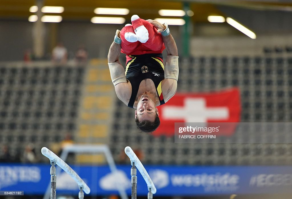 Germanys Sebastian Krimmer performs during the Mens Parallel Bars competition of the European Artistic Gymnastics Championships 2016 in Bern, Switzerland on May 28, 2016. / AFP / FABRICE