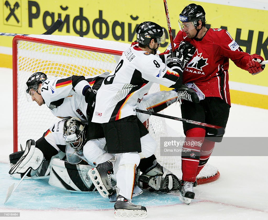 Germany's Sebastian Osterloh and Michael Bakos fights for the puck with Canada's Justin Williams during the IIHF World Ice Hockey Championship...