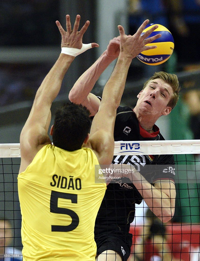 Germany's Sebastian Schwarz attacks during the FIVB World Championships match between Brazil and Germany on September 1, 2014 in Katowice, Poland.