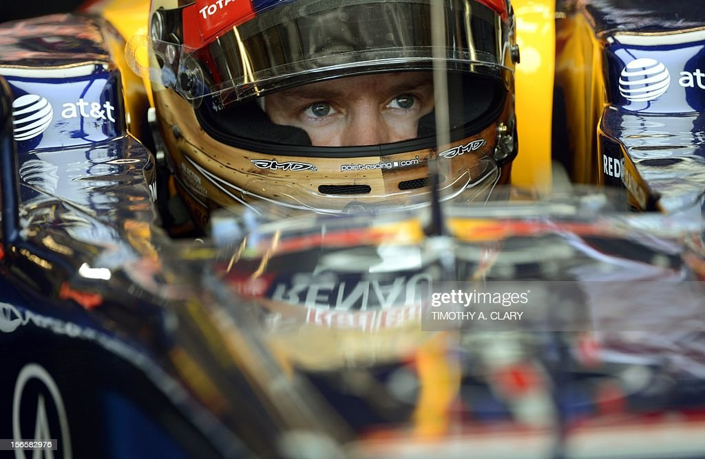 Germany's Sebastian Vettel of Red Bull racing sits in his car in the pits during the third practice session for the United States Formula One Grand Prix at the Circuit of the Americas on November 17, 2012 in Austin, Texas.