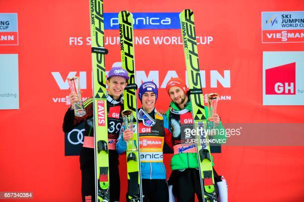 Germany's second place Andreas Wellinger Austria's winner Stefan Kraft and Germany's third placed Markus Eisenbichler pose on the podium of the FIS...