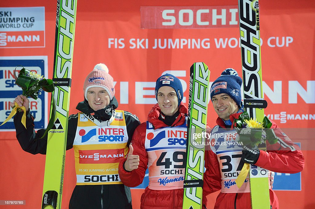Germany's second-placed Severin Freund, Austria's gold winner Gregor Schlierenzauer and Austria's third-placed Andreas Kofler celebrate on the podium after the men's normal hill individual at the FIS Ski Jumping World Cup tournament in Sochi on December 8, 2012.