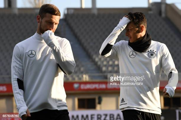 Germany's Shkodran Mustafi and Mesut Ozil take part in a training session in Baku on March 25 2017 on the eve of the FIFA World Cup 2018...