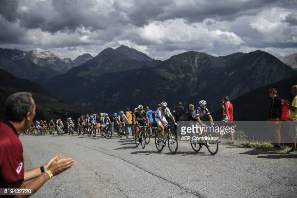 Germany's Simon Geschke France's Brice Feillu and Belgium's Serge Pauwels leads the pack as supporters cheer during the 1795 km eighteenth stage of...