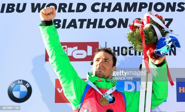 Germany's Simon Schempp celebrates his victory on the podium after the 2017 IBU World Championships Biathlon Men's 15 km Mass start race in...