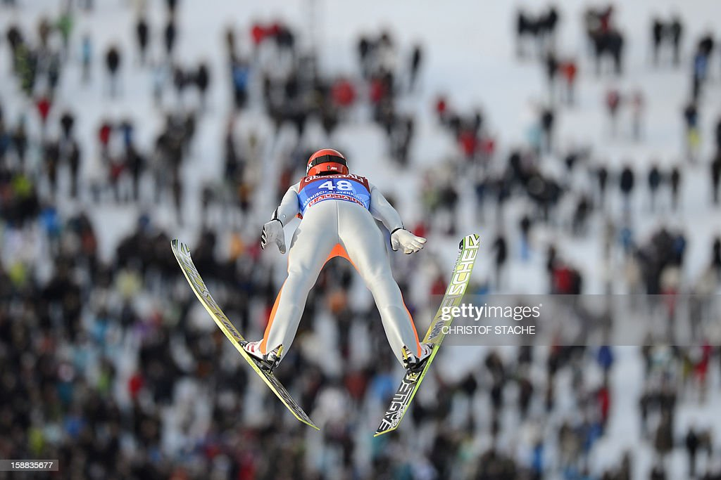 Germany's ski jumper Andreas Wank soars through the air during his qualification jump at the 61th edition of the Four-Hills-Tournament (Vierschanzentournee) on December 31, 2012 in Garmisch-Partenkirchen, southern Germany. The second competition of the jumping event will take place in Garmisch-Partenkirchen, before the tournament continues in Innsbruck (Austria) and in Bischofshofen (Austria).