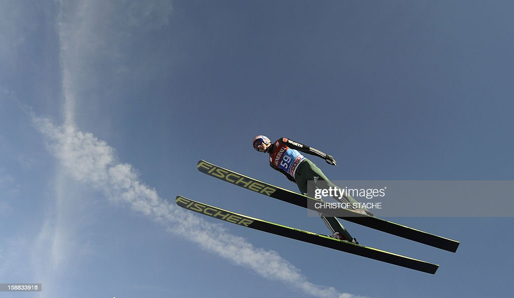 Germany's ski jumper Michael Neumayer soars through the air during his trial jump at the 61th edition of the Four-Hills-Tournament (Vierschanzentournee) on December 31, 2012 in Garmisch-Partenkirchen, southern Germany. The second competition of the jumping event will take place in Garmisch-Partenkirchen, before the tournament continues in Innsbruck (Austria) and in Bischofshofen (Austria). AFP PHOTO/CHRISTOF STACHE