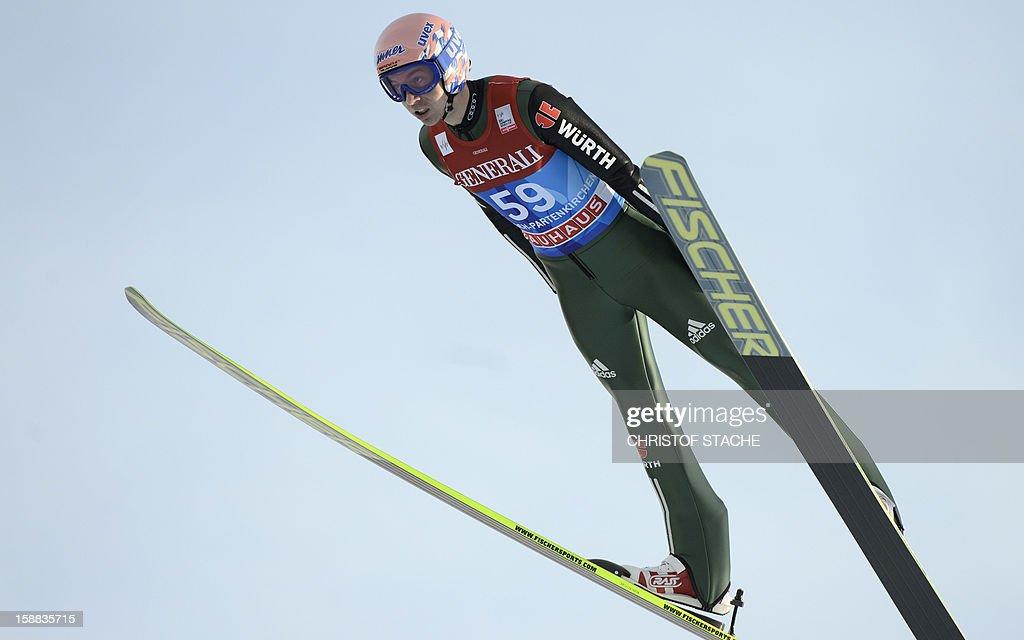 Germany's ski jumper Michael Neumayer soars through the air during his trial jump at the 61th edition of the Four-Hills-Tournament (Vierschanzentournee) on December 31, 2012 in Garmisch-Partenkirchen, southern Germany. The second competition of the jumping event will take place in Garmisch-Partenkirchen, before the tournament continues in Innsbruck (Austria) and in Bischofshofen (Austria).