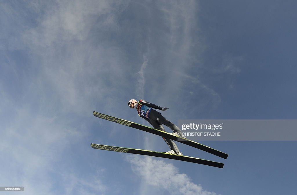 Germany's ski jumper Severin Freund soars through the air during his trial jump at the 61th edition of the Four-Hills-Tournament (Vierschanzentournee) on December 31, 2012 in Garmisch-Partenkirchen, southern Germany. The second competition of the jumping event will take place in Garmisch-Partenkirchen, before the tournament continues in Innsbruck (Austria) and in Bischofshofen (Austria).