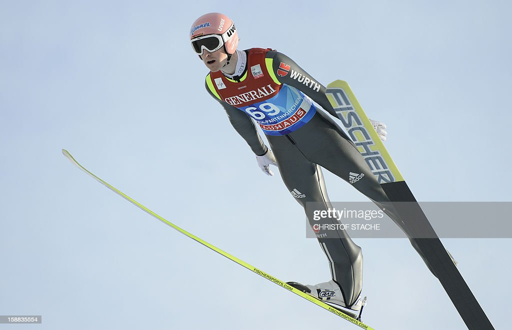 Germany's ski jumper Severin Freund soars through the air during his trial jump at the 61th edition of the Four-Hills-Tournament (Vierschanzentournee) on December 31, 2012 in Garmisch-Partenkirchen, southern Germany. The second competition of the jumping event will take place in Garmisch-Partenkirchen, before the tournament continues in Innsbruck (Austria) and in Bischofshofen (Austria). AFP PHOTO/CHRISTOF STACHE