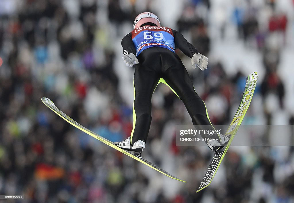 Germany's ski jumper Severin Freund soars through the air during his qualification jump at the 61th edition of the Four-Hills-Tournament (Vierschanzentournee) on December 31, 2012 in Garmisch-Partenkirchen, southern Germany. The second competition of the jumping event will take place in Garmisch-Partenkirchen, before the tournament continues in Innsbruck (Austria) and in Bischofshofen (Austria).