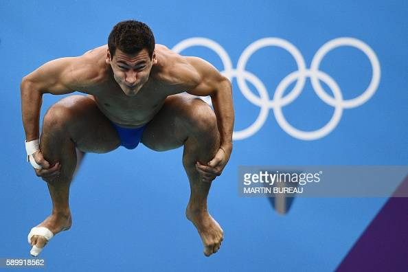 TOPSHOT Germany's Stephan Feck competes in the Men's 3m Springboard Preliminary during the diving event at the Rio 2016 Olympic Games at the Maria...