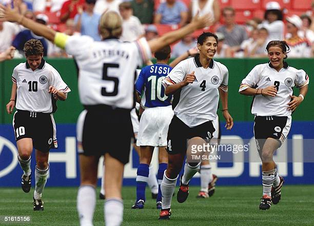 Germany's Stephanie Ann Jones celebrates her goal with teammates Bettina Wiegman and Sandra Minnert Suzana during the first round of the Womens World...