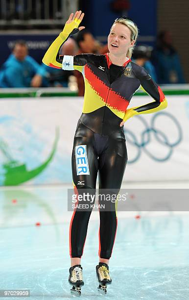 Germany's Stephanie Beckert waves after competing in the women's 2010 Winter Olympics 5000m speedskating event at the Olympic Oval in Richmond...