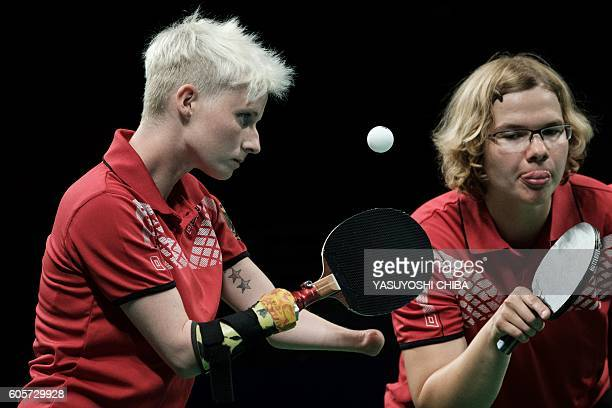 Germany's Stephanie Grebe and Juliane Wolf compete against Brazil during the quarterfinal of the women's team table tennis in the Rio 2016 Paralympic...