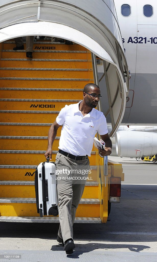 Germany's striker Cacau gets off the plane in Verona May 21, 2010, as the German team arrives for a 12-day long training camp near Bolzano to prepare for the upcoming FIFA Football World Cup in South Africa.