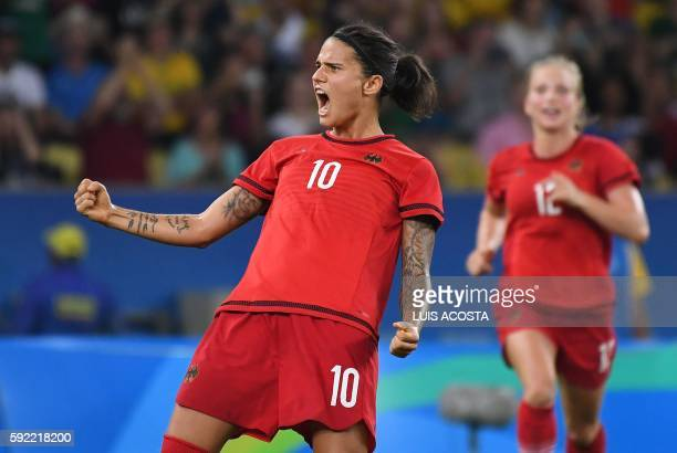 Germany's striker Dzsenifer Marozsan celebrates her team's second goal after Sweden's defender Linda Sembrant scored an own goal during the Rio 2016...