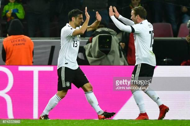 Germany's striker Lars Stindl celebrates scoring the 22 with his teammate midfielder Mario Goetze during the international friendly football match...