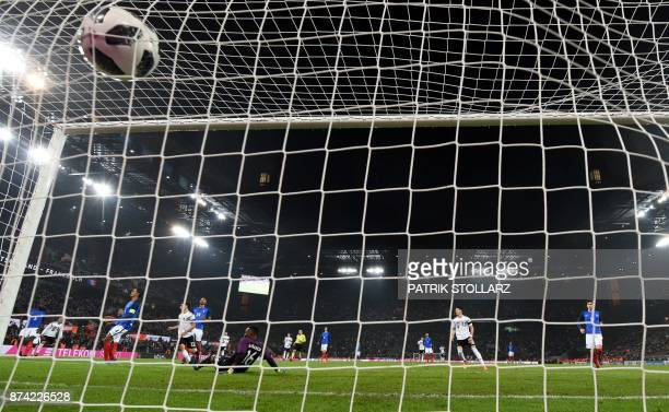 Germany's striker Lars Stindl score past France's goalkeeper Steve Mandanda during the international friendly football match Germany against France...