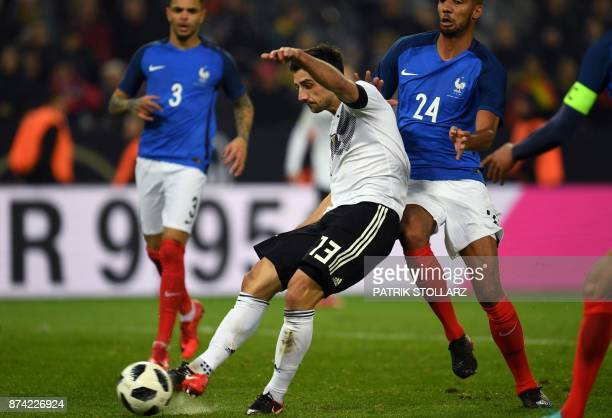 Germany's striker Lars Stindl scores the 22 during the international friendly football match Germany against France in Cologne on November 14 2017...