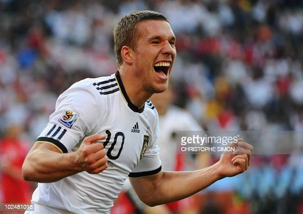 Germany's striker Lukas Podolski celebrates with teammates after scoring a second goal during the 2010 World Cup round of 16 match Germany vs England...