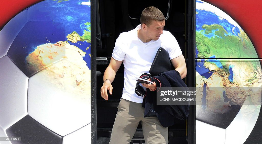 Germany's striker Lukas Podolski leaves the team bus before getting on a plane in Palermo May 21, 2010, as the German football team left Sicily for a 12-day long training camp near Bolzano to prepare for the upcoming FIFA Football World Cup in South Africa.