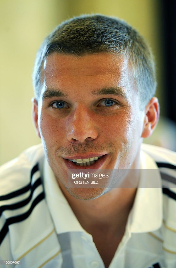 Germany's striker Lukas Podolski poses for photographers during a so-called media day at the Verdura Golf and Spa resort, near Sciacca May 19, 2010. The German team is currently taking part in a 'Regeneration' camp in Sicily to prepare for the upcoming FIFA Football World Cup in South Africa.