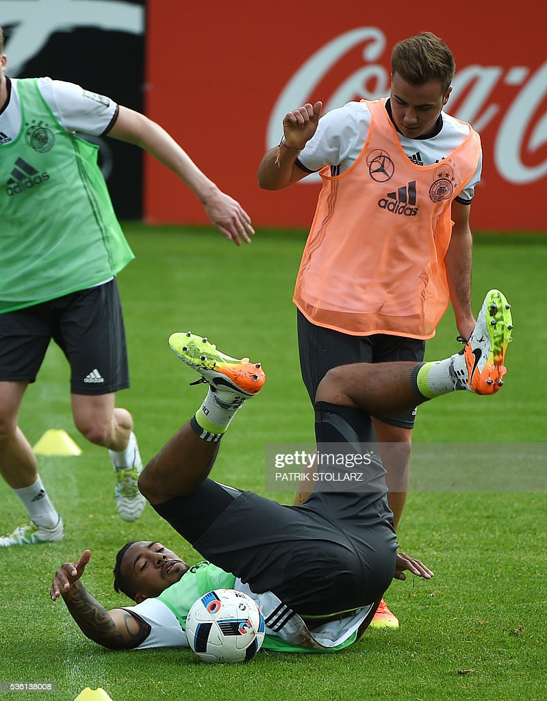 Germany's striker Mario Goetze (R) and Germany's defender Jerome Boateng vie for the ball during a training session on May 31, 2016 in Ascona as part of the team's preparation for the upcoming Euro 2016 European football championships. / AFP / PATRIK