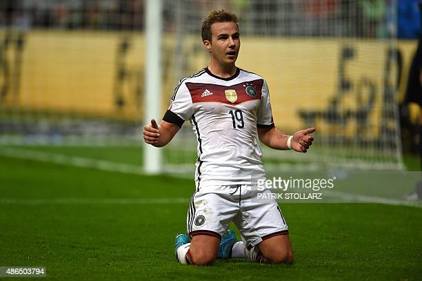 Germany's striker Mario Goetze celebrates scoring during the Euro 2016 qualifying football match between Germany and Poland in Frankfurt am Main...