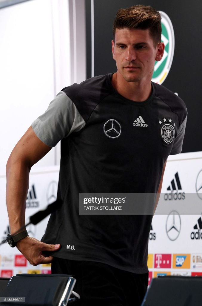 Germany's striker Mario Gomez arrives to give a press conference at the team's training ground in Evian-les-Bains on June 29, 2016 during the Euro 2016 football tournament. / AFP / PATRIK