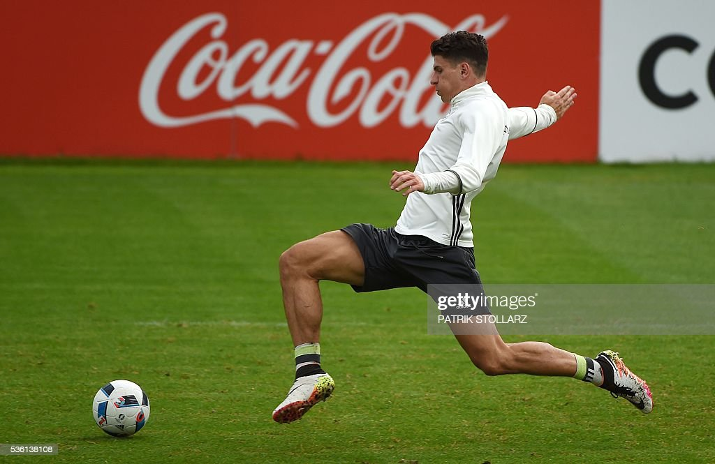 Germany's striker Mario Gomez controls the ball during a training session on May 31, 2016 in Ascona as part of the team's preparation for the upcoming Euro 2016 European football championships. / AFP / PATRIK