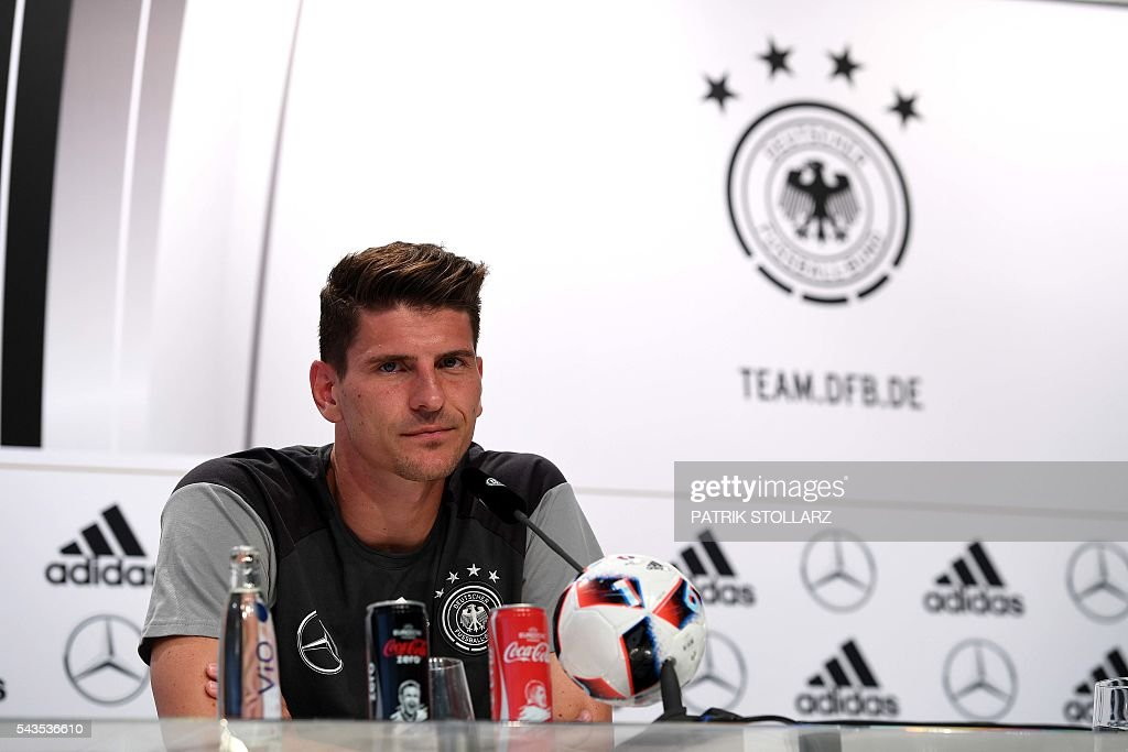 Germany's striker Mario Gomez gives a press conference at the team's training ground in Evian-les-Bains on June 29, 2016 during the Euro 2016 football tournament. / AFP / PATRIK