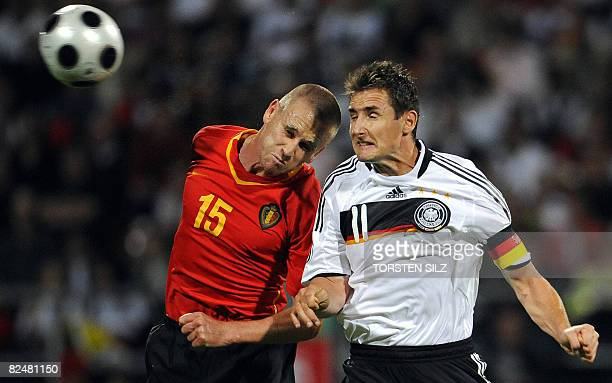 Germany's striker Miroslav Klose and Belgium's Filip Daems during the friendly international football match between Germany and Belgium in the...