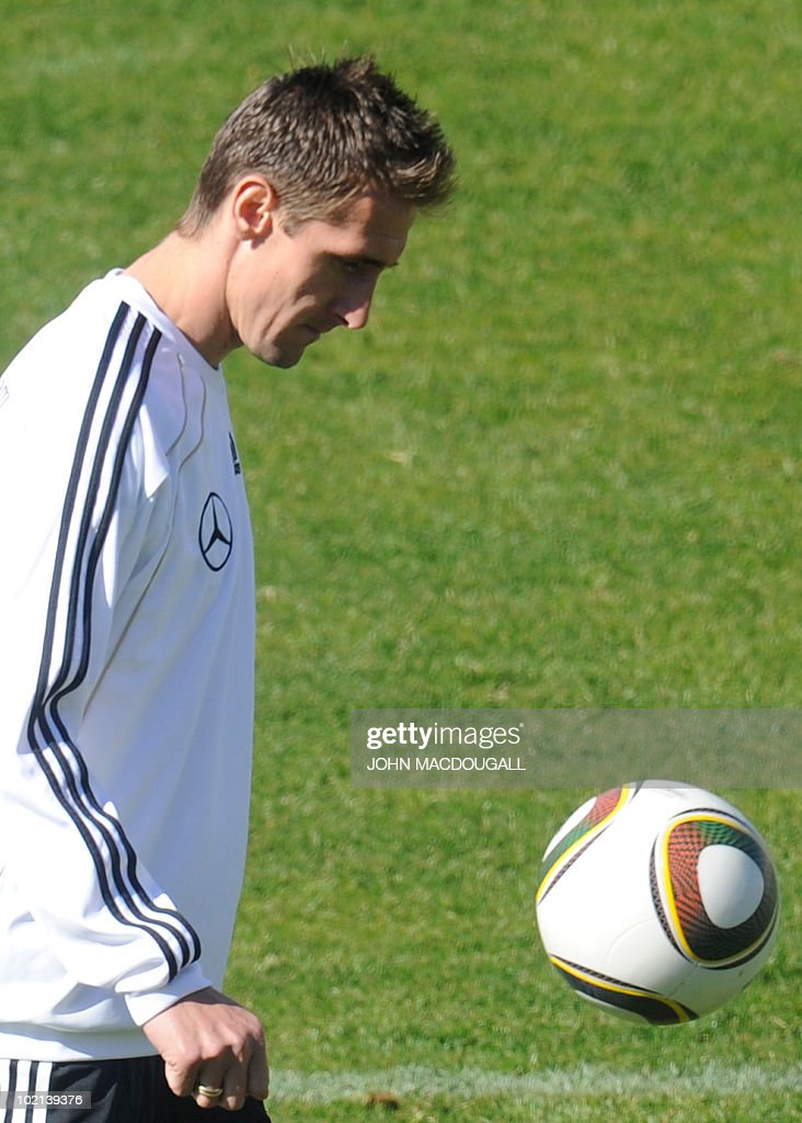 Germany's striker Miroslav Klose warms up with the ball during a training session at the Super stadium in Atteridgeville near Pretoria June 16, 2010. The 2010 World Cup hosted by South Africa continues through July 11.