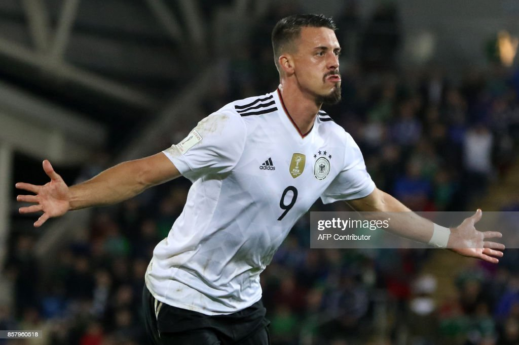 TOPSHOT - Germany's striker Sandro Wagner celebrates after scoring their second goal during the FIFA World Cup 2018 qualification football match between Northern Ireland and Germany at the National Football Stadium at Windsor Park in Belfast on October 5, 2017. / AFP PHOTO / Paul FAITH