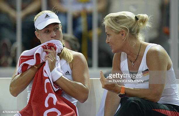 Germany's team captain Barbara Rittner talks to Germany's Angelique Kerber during her match against Russia's Anastasia Pavlyuchenkova at the...