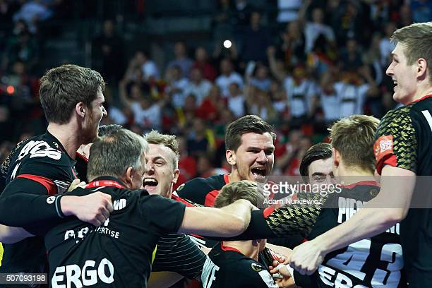 Germany's team celebrate after victory during the Men's EHF Handball European Championship 2016 match between Germany and Denmark at Centennial Hall...