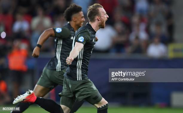 Germany's team celebrates victory after winning 34 on penalties during the UEFA U21 European Championship football semi final match England v Germany...