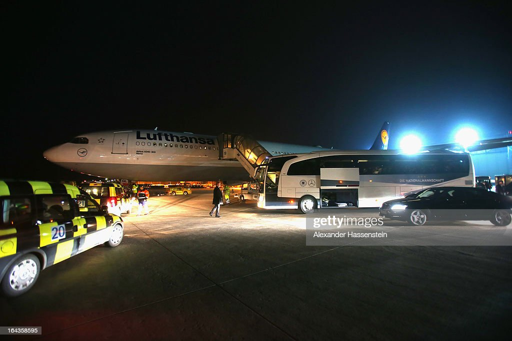Germany`s team coach parks next to Lufthansa Airbus A 340 charter plane after arriving with the team from Astana, Kazakhstan, at Nuremberg airport after their FIFA 2014 World Cup qualifier group C match between Kazakhstan and Germany on March 23, 2013 in Nuremberg, Germany.