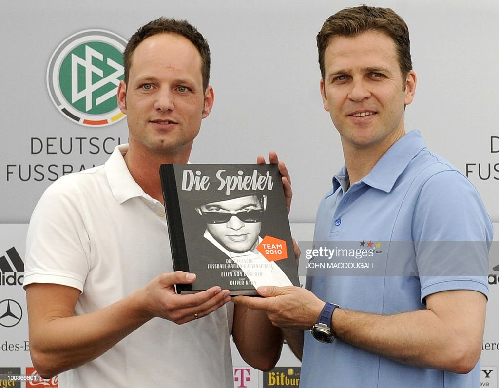 Germany's team manager Oliver Bierhoff (R) and publicist for the Medienfabrik Guetersloh Stephan Braun display a book of photographs called 'The Players' featuring black and white photographs of some of Germany's football players, during a press conference in Appiano, near the north Italian city of Bolzano May 24, 2010. The German football team is currently taking part in a 12-day training camp in Appiano to prepare for the upcoming FIFA Football World Cup in South Africa.