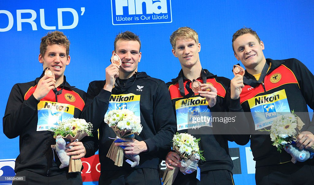 Germany`s team members hold their bronze medals on the podium after the men's 4x200 freestyle finals on December 13, 2012 during the FINA World Short Course Swimming Championships in Istanbul.