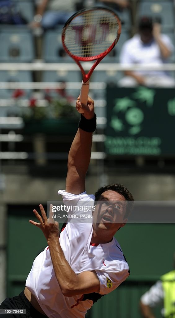 Germany's tennis player Philipp Kohlschreiber serves against Argentina's tennis player Carlos Berlocq, during their 2013 Davis Cup World Group first round single tennis match, at Parque Roca stadium in Buenos Aires, on February 1, 2013. AFP PHOTO / ALEJANDRO PAGNI