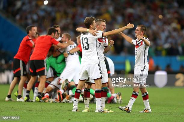 Germany's Thomas Muller Bastian Schweinsteiger and captain Philipp Lahm celebrate at the final whistle