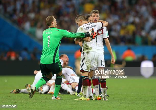 Germany's Thomas Muller Bastian Schweinsteiger and Manuel Neuer during the FIFA World Cup Final at the Estadio do Maracana Rio de Janerio Brazil