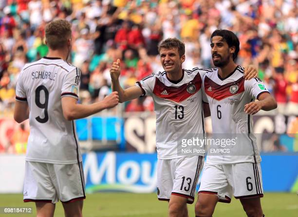 Germany's Thomas Muller celebrates scoring his side's fourth goal of the game to complete his hattrick with Andre Schurrle and Sami Khedira