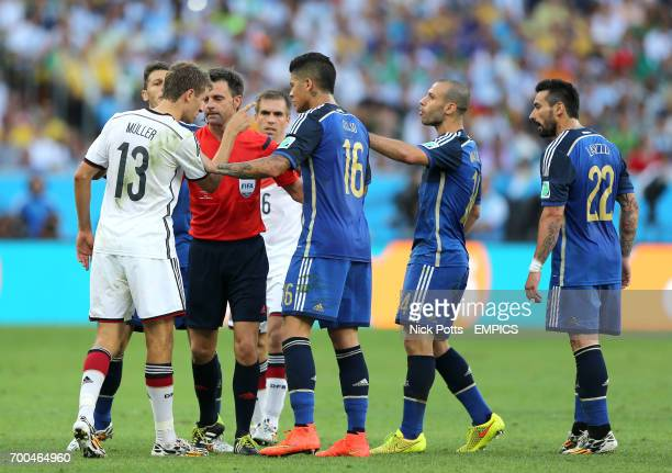 Germany's Thomas Muller exchanges heated words with Argentina's Javier Mascherano and Marcos Rojo